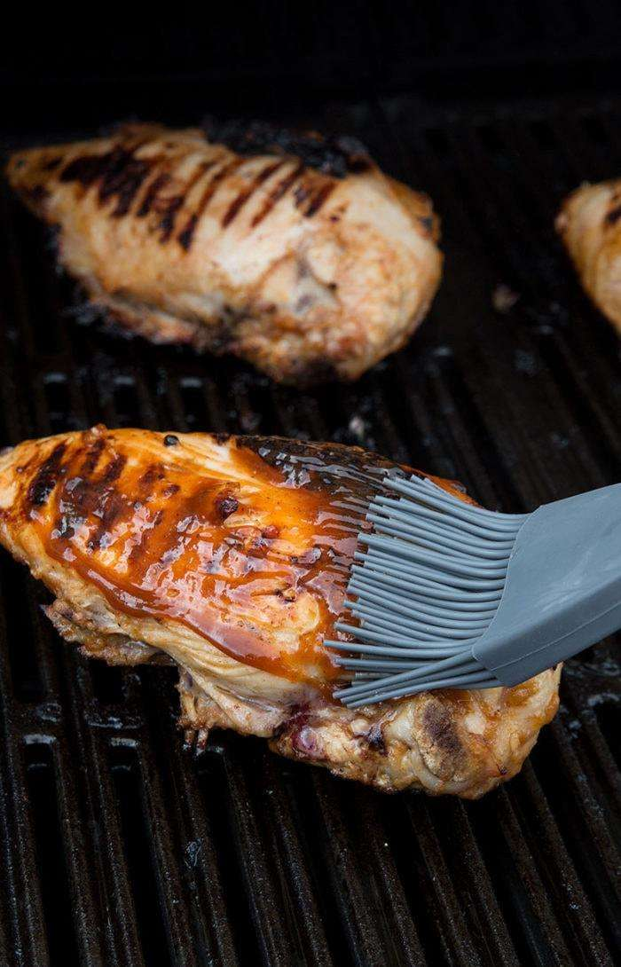 Basting Chicken with Low Carb Barbecue Chicken Marinade.